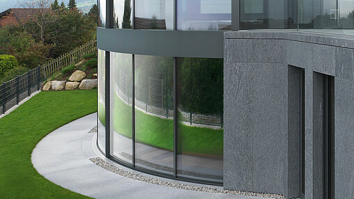 Curved sliding windows with central opening